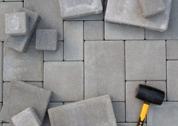 concrete-paving-wtih-hammer at townsville pavers