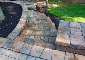 travertine pavers installed in a garden at Townsville Pavers